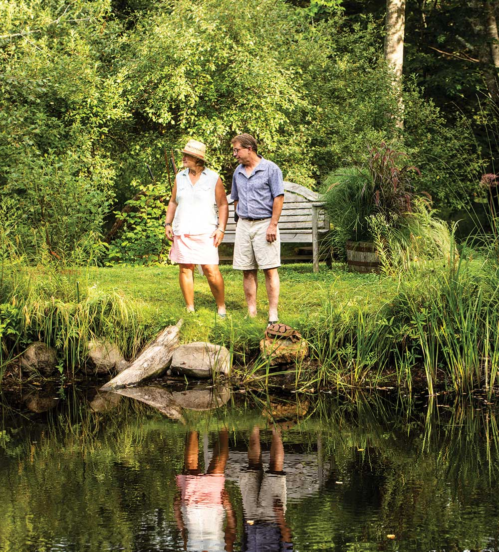 Clapp and her husband, Blaise de Sibour, stand before a pond formed by excavating a small wet area