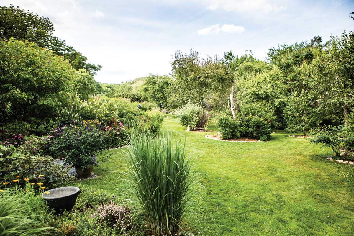 a transitional landscape separates the formal and cottage gardens