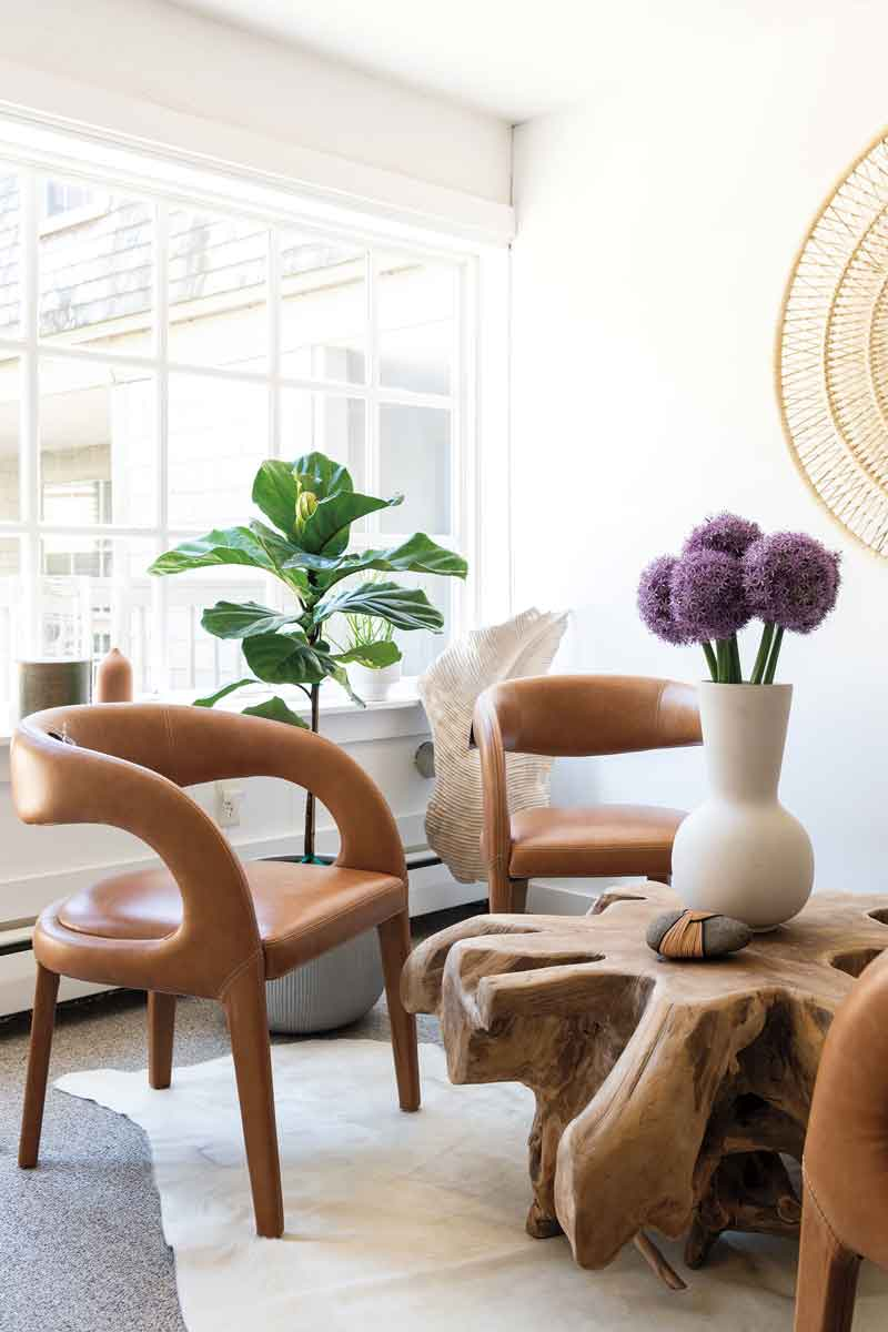 leather chairs pair with an Indonesian teak-root table, a one-of-a-kind market find.