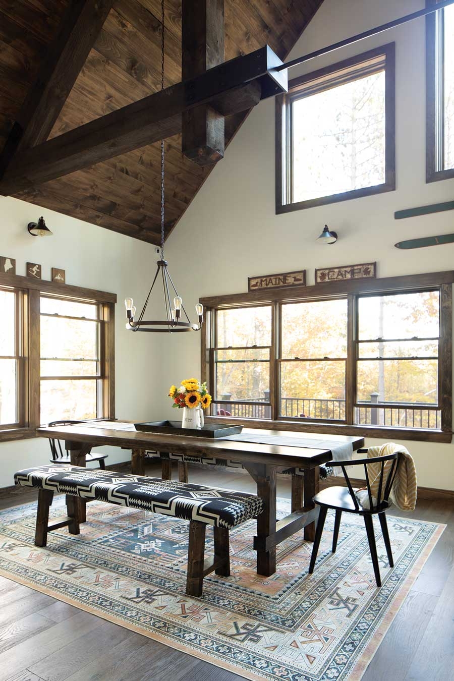 Eric's father, David LaCroix, built the pine farmhouse table and benches, upholstered in Pendleton wool by a friend.