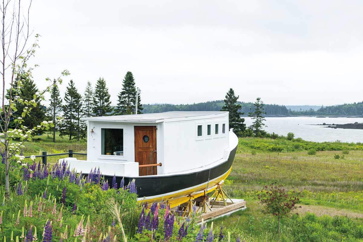 Julie and Rich Rose's lobster boat-turned-lounge points toward Holmes Bay.