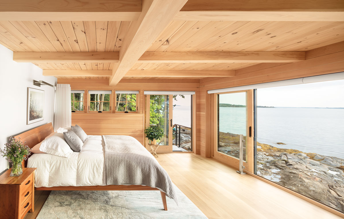 There's only a hint of Sheetrock in this fir-paneled bedroom in a new home Portland's Kaplan Thompson Architects and Freeport's Warren Construction Group erected in the footprint of an old summer place on Casco Bay.
