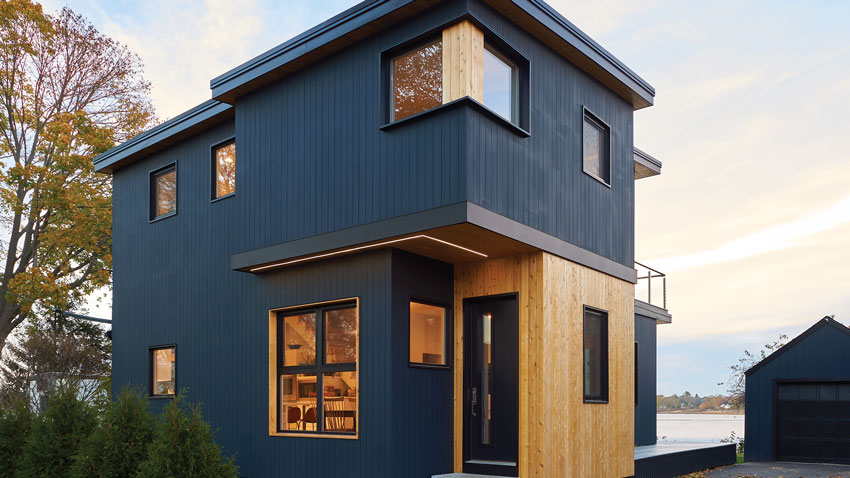 Working with the foundation and framing of an existing Cape, Portland architectural designer Chris Herlihy created a cubist ode with an airy new plan.
