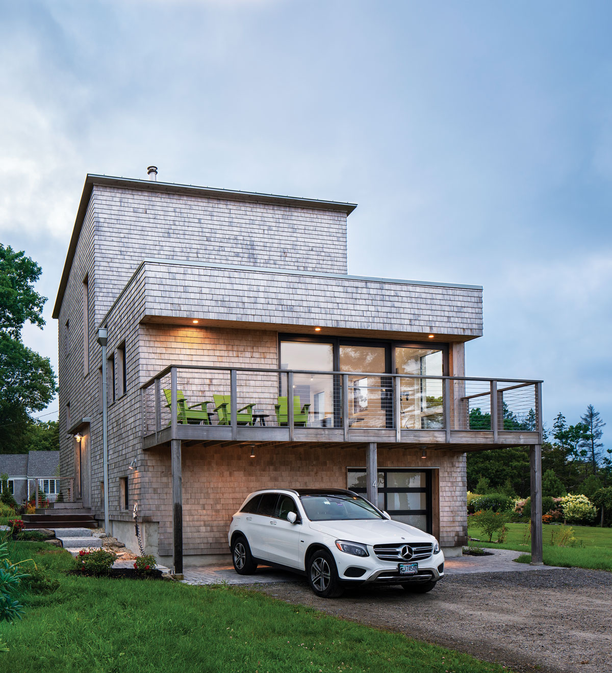 Stacy Emack and Ed Fels's Cape Elizabeth home incorporates eastern-white-cedar shingles, a standing- seam metal shed roof, and a PVC flat roof.